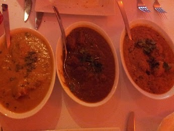 (from left to right) Mango chicken, beef vindaloo, and dum aloo